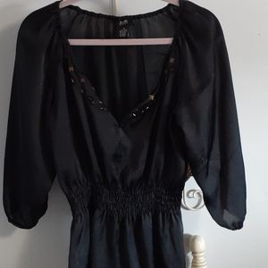 Black color blouse with beautiful beading .